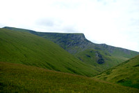Blencathra summit on left and sharp edge ridge. trail on side of hill then climbs up to lake.