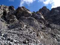 Cross around to right to find scree gully which goes up to left