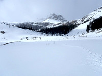 Two pic pano from 1st bench on moraine route to Peyto. Canyon to left.
